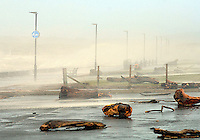 Driftwood and debris thrown up from the sea at the car park and green on Prestwick Promenade. ...The gale force winds and driving rain arrive in the West of Scotland. Picture: Maurice Marwood/Universal News And Sport (Scotland). 8 December 2011. www.unpixs.com.