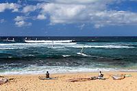 Windsurfers at Ho'okipa Beach on Maui.