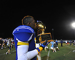 Oxford High's Darius Liggins (9) holds the Crosstown Classic trophy vs. Lafayette High at Bobby Holcomb Field in Oxford, Miss. on Thursday, August 30, 2012. Oxford High won 19-0.