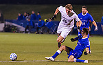 Xavier midfielder Garrett Halfhill goes down after a hard challenge from UK's Steven Perinovic during the first half.
