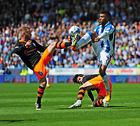 Sheffield Wednesday's Barry Bannan vies for possession with Huddersfield Town's Elias Kachunga<br /> <br /> Photographer Chris Vaughan/CameraSport<br /> <br /> The EFL Sky Bet Championship Play-Off Semi Final First Leg - Huddersfield Town v Sheffield Wednesday - Saturday 13th May 2017 - The John Smith's Stadium - Huddersfield<br /> <br /> World Copyright &copy; 2017 CameraSport. All rights reserved. 43 Linden Ave. Countesthorpe. Leicester. England. LE8 5PG - Tel: +44 (0) 116 277 4147 - admin@camerasport.com - www.camerasport.com