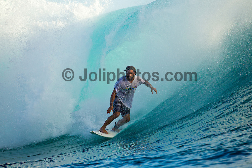 Teahupoo, Tahiti Iti, French Polynesia. Wednesday August 17 2011. A new  west swell was hitting the main reef today with clean open barrels in the six foot range. Photo: joliphotos.com