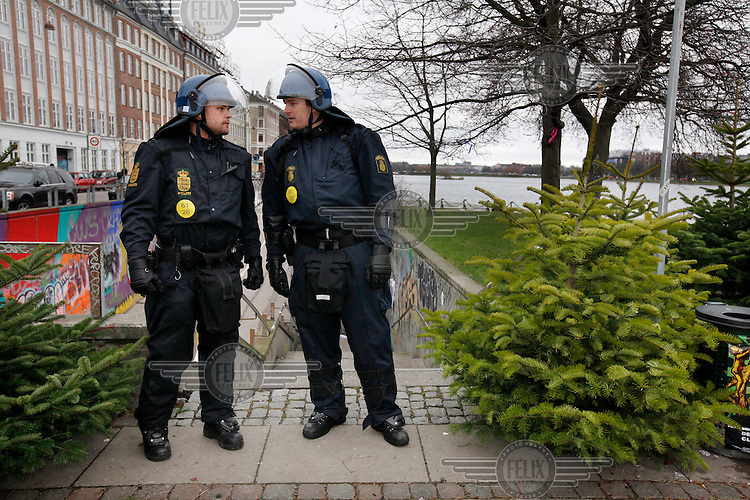 Police and Christmas trees. United Nations Climate Change Conference (COP15) was held at Bella Center in Copenhagen from the 7th to the 18th of December, 2009. A great deal of groups tried to voice their opinion and promote their cause in various ways. The conference and demonstrations was covered by thousands of photographers and journalists from all over the world...©Fredrik Naumann/Felix Features.
