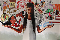 Defiant to Your Gods, acrylic paint on wood panel, 2015, by Gregg Deal, Paiute American artist, b. 1975, from the collection of Denver Art Museum, Denver, Colorado, USA. The painting shows a young Native American girl standing defiantly amid stereotypes of her culture from American popular culture. Picture by Manuel Cohen