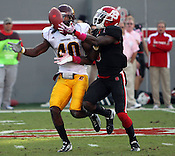 T.J. Graham reaches for a catch as John Carr tries to block. NC State defeated Central Michigan 38-24 on Saturday, October 8, 2011 at Carter-Finley Stadium in Raleigh. Photo by Al Drago.