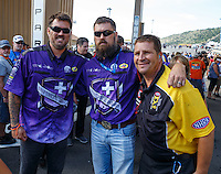 Jul 24, 2016; Morrison, CO, USA; NHRA safety safari official Randy West poses for a photo with Morgan and Marcus Luttrell during the Mile High Nationals at Bandimere Speedway. Mandatory Credit: Mark J. Rebilas-USA TODAY Sports