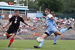 15 August 2014: North Carolina's Jonathan Campbell (right) and Gardner-Webb's Jake Kennedy (left). The University of North Carolina Tar Heels hosted the Gardner-Webb University Bulldogs at Fetzer Field in Chapel Hill, NC in a 2014 NCAA Division I Men's Soccer preseason match. North Carolina won the exhibition 7-0.