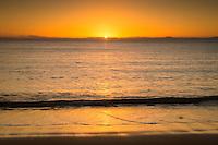 Sunrise on golden beach in Totaranui, Abel Tasman National Park, Nelson Region, New Zealand