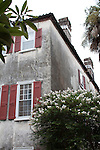 Old Historic home in Charleston South Carolina with Red window shutters