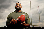 September 30, 2011; Owings Mills, MD, USA; Baltimore Ravens offensive tackle Michael Oher poses for a portrait at McDonogh Stadium for Terminix in Owings, Mills, MD. Brian Schneider-www.ebrianschneider.com