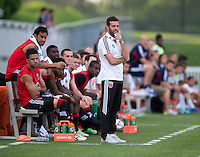 D.C. United head coach Ben Olsen watches his team during the quarterfinals of the US Open Cup at the Maryland SoccerPlex in Boyds, Md.  D.C. United defeated the New England Revolution, 3-1.