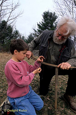 1Y06-034x  Earthworm - calling earthworms with stake and leaf spring - boy with older man