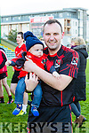 Fossa's Colin Mayers with son Micheal after winning the Castleisland Mart Junior Club Football Championship Final Replay against Beale at Austin Stack Park on Sunday