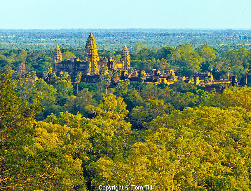 Angkor Watt   towers rise above jungle      Angkot Wat Archeological Park, Cambodia    Built 1113-1150 AD     Khymer culture ruins