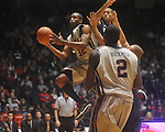 "Mississippi guard Zach Graham (32) shoots as East Tennessee State's Curtis Wilkinson (45) defends at the C.M. ""Tad"" Smith Coliseum in Oxford, Miss. on Saturday, December 18, 2010. Ole Miss won 71-50. Graham scored 14."