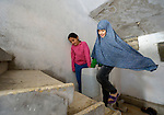 Rahaf, 9, and her sister Rawan, 10, carry water up the stairs of their apartment building in Amman, Jordan. Their family of eight fled the city of Homs, Syria, as fighting there worsened in 2012. Their home in Syria has since been destroyed by bombing, and the family is struggling to survive in Jordan's capital city. Because they couldn't pay the water bill for their small apartment, the water was cut off, and they have to purchase water and carry it up the stairs. The family has received help from International Orthodox Christian Charities, a member of the ACT Alliance.