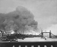 This picture, taken during the first mass air raid on London, 7th Sept. 1940, describes more than words ever could, the scene in London's dock area.  Tower Bridge stands out against a background of smoke and fires.  New Times Paris Bureau Collection.  (USIA)<br /> NARA FILE #:  306-NT-2743V<br /> WAR &amp; CONFLICT BOOK #:  1004