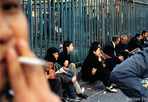 France, Paris, 05-2003.Clandestine Chinese immigrants wait around for temporary work in Paris. They are part of a new wave of immigrants from China?s northeast, home to millions of former cradle-to-grave factory workers laid off by closures. ..