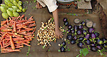A man sells vegetables in the market in Lahore.