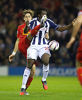 WEST BROMWICH, ENGLAND - Wednesday, September 26, 2012: West Bromwich Albion's Romelu Lukaku in action against Liverpool's Sebastian Coates during the Football League Cup 3rd Round match at the Hawthorns. (Pic by David Rawcliffe/Propaganda)