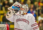 24 November 2013: University of Massachusetts Goaltender Steve Mastalerz, a Junior from North Andover, MA, hydrates in the second period against the University of Vermont Catamounts at Gutterson Fieldhouse in Burlington, Vermont. The Cats shut out the Minutemen 2-0 to sweep the 2-game home-and-away weekend Hockey East Series. Mandatory Credit: Ed Wolfstein Photo *** RAW (NEF) Image File Available ***