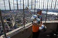 New York, USA. 23 April 2014.  Supercross motorcycle racer  Ken Roczen holds the trophy while they promote their motorcycle race during a visit to the Empire State Building in New York. Photo by Eduardo Munoz Alvarez/VIEWpress