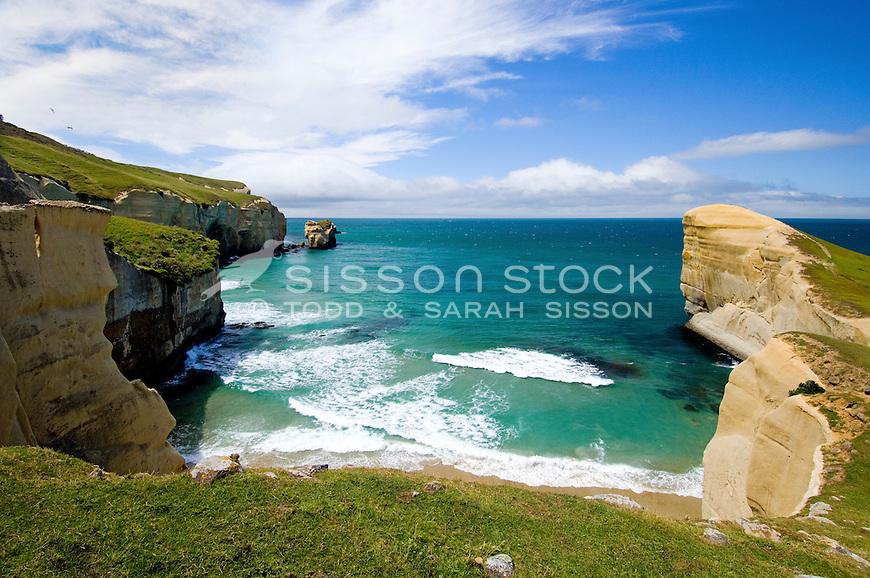 Tunnel Beach on the Otago Coast near Dunedin Blue sky | white cliffs | crashing waves blue water / sea