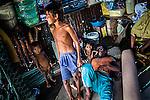 Bajau family in their pile dwelling on Omadal Island