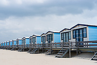 Blue cabanas for rent on a sandy beach