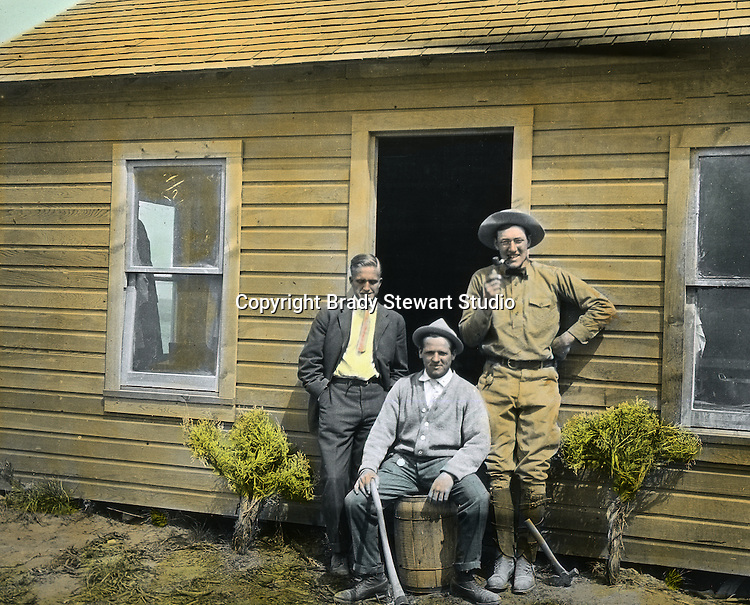 Jerome ID:  Tawney, Torrance and friend from Pittsburgh posing in front of the homestead - 1909.  Brady Stewart and three friends went to Idaho on a lark from 1909 thru early 1912.  As part of the Mondell Homestead Act, they received a grant of 160 acres north of the Snake River.  Brady Stewart photographed the adventures of farming along with the spectacular landscapes. To give family and friends a better feel for the adventure, he hand-color black and white negatives into full-color 3x4 lantern slides.  The Process:  He contacted a negative with another negative to create a positive slide.  He then selected a fine brush and colors and meticulously created full color slides.