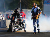 Jun 3, 2016; Epping , NH, USA; NHRA top fuel Harley motorcycle rider Len Darnell with crew member during qualifying for the New England Nationals at New England Dragway. Mandatory Credit: Mark J. Rebilas-USA TODAY Sports