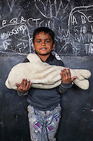 Farman, 5, poses for a portrait with a soft toy in the Guria Non-Formal Education center in the middle of the Shivdaspur red light district, Varanasi, Uttar Pradesh, India on 20 November 2013. Guria uses the soft toys as a form of therapy for the children of the women in prostitution and also use it as signals of the children's emotional wellbeing.