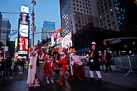People dressed in merry christmas characters pose for a picture as they take part at the Santacon's Annual Festival at Times Square in New York, United States. 14/12/2012. Photo by ZAMEK