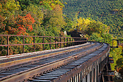 Crawford Notch State Park - Frankenstein Trestle along the old Maine Central Railroad in the White Mountains, New Hampshire USA during the autumn months. Since 1995 the Conway Scenic Railroad, which provides passenger excursion trains has been using the track