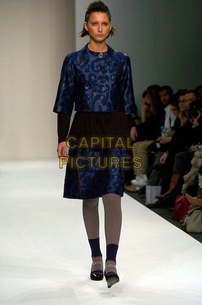 MODEL.At the Eley Kishimoto a/w 2007/8 Catwalk Show during London Fashion Week, BFC Tent, London, England, February 16th 2007..full length runway modelling navy blue patterned skirt jacket suit.CAP/CAN.©Can Nguyen/Capital Pictures
