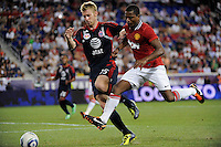 Patrice Evra (3) of Manchester United is defended by Tim Ream (15) of the MLS All-Stars. Manchester United defeated the MLS All-Stars 4-0 during the MLS ALL-Star game at Red Bull Arena in Harrison, NJ, on July 27, 2011.