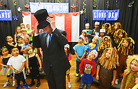 Gary Cosby Jr./Decatur Daily     Governor Robert Bentley visits Walter Jackson Elementary School in Decatur Monday.  The governor dons a ring master's hat as he is included in a dress rehearsal by the kindergarten class.