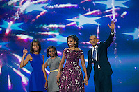 President Barack Obama, first lady Michelle Obama, and their daughters  Sasha and Malia, right, wave to the crowd following the President's speech at the Democratic National Convention at Time Warner Cable Arena in Charlotte, N.C., on Thursday, Sept. 6, 2012.