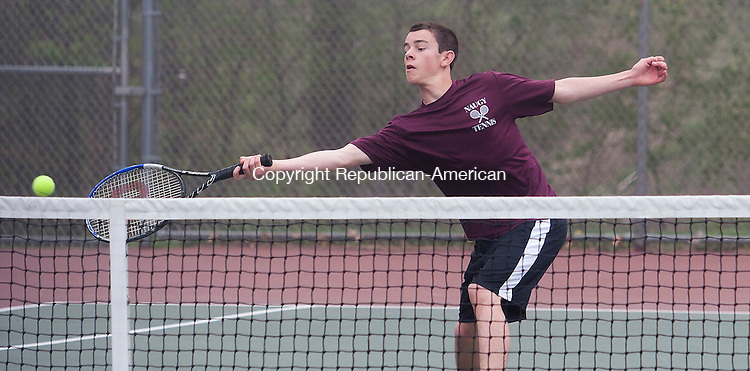 WOLCOTT, CT - 09 APRIL 2015 - 050915JW04.jpg -- PJ Morrissey of Naugatuck returns against Wolcott Matt Mastropietro during NVL match at Wolcott Saturday morning. Jonathan Wilcox Republican-American