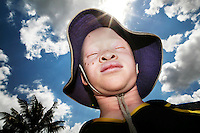 """Eight year old Peter Charles wears a hat to protect him from the sun. His mother is a nurse, so knew how to take care of him and his sister, """"I knew how to take care of the skin. Especially when they are young, albinos should be very well cared for. I always kept them inside and lotioned their skin on a daily basis."""" Even with the protection of a knowledgeable and loving mother, Joyce, Peter Charles's albino sister, was recently terrified while waiting for the school bus. She overheard two men saying how they should kidnap her in order to sell her hair and skin. Discrimination against albinos is a serious problem throughout sub-Saharan Africa, but recently in Tanzania albinos have been killed and mutilated, victims of a growing criminal trade in albino body parts fuelled by superstition and greed. Limbs, skin, hair, genitals and blood are believed by witch doctors to bring good luck, and are sold to clients for large sums of money, carrying with them the promise of instant wealth."""