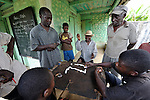 Men play dominos in Despagne, an isolated village in southern Haiti where the Lutheran World Federation has been working with residents to improve their quality of life.