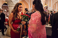 Australian violinist Niki Vasilakis (left) and Princess Diya Kumari of the Royal Family of Jaipur share a light conversation after her solo violin concert played to a prominent audience, including the Jaipur Royal Family, and other VIPs at the OzFest Gala Dinner in the Jaipur City Palace, in Rajasthan, India on 10 January 2013. Photo by Suzanne Lee