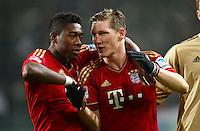 FUSSBALL   1. BUNDESLIGA   SAISON 2012/2013    22. SPIELTAG VfL Wolfsburg - FC Bayern Muenchen                       15.02.2013 Schlussjubel: David Alaba (li) und Bastian Schweinsteiger (re, beide FC Bayern Muenchen)