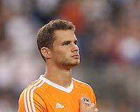 Foxborough, Massachusetts - August 15, 2015: In a Major League Soccer (MLS) match, the New England Revolution (blue/white) vs Houston Dynamo (orange) at Gillette Stadium.
