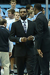 21 December 2013: North Carolina's P.J. Hairston sat on the bench in a suit despite announcing the end of his playing career at UNC earlier in the week. The University of North Carolina Tar Heels played the Davidson College Wildcats at the Dean E. Smith Center in Chapel Hill, North Carolina in a 2013-14 NCAA Division I Men's Basketball game. UNC won the game 97-85 in overtime.