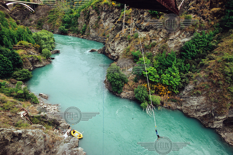 Bungee jumping at the historic 1880 Kawarau Bridge, which became the world's first commercial bungee site in 1988.  The river runs 43 metres below the bridge. ....