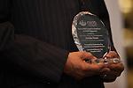 President Roderick McDavis holds an award for Haruka Wazaki during the Global Engagement Awards Gala in Nelson Commons, on Thursday, November 19, 2015. Photo by Kaitlin Owens