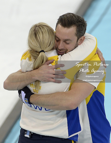 Swedish coach Eva Lund celebrates with Niklas Edin (SWE, skip).  (SWE). Mens curling - Bronze medal match - SWE v CHN - Ice Cube Curling Centre - Olympic Park - PHOTO: Mandatory by-line: Garry Bowden/SIPPA/Pinnacle - Photo Agency UK Tel: +44(0)1363 881025 - Mobile:0797 1270 681 - VAT Reg No: 768 6958 48 - 210214 - 2014 SOCHI WINTER OLYMPICS - Ice Cube Curling Centre, Sochi, Russia