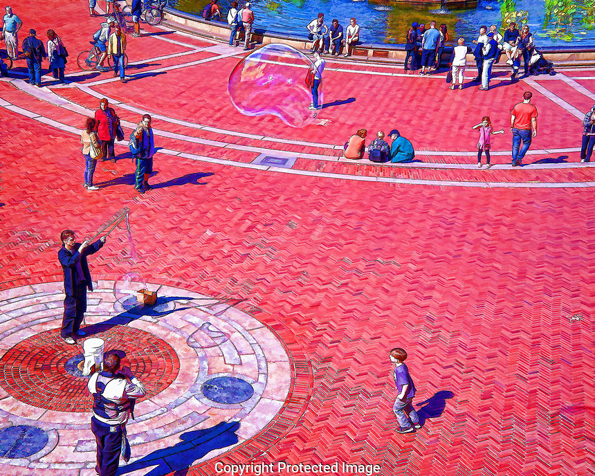 This image is at the boathouse pavilion in Central Park. The performer is creating a soap bubble while one is seen floating in the air at the top of the picture.