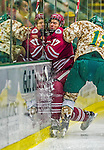 25 November 2014: University of Massachusetts Minutemen Defenseman Brennan Baxandall, a Sophomore from Calgary, Alberta, is checked into the boards during a game against the University of Vermont Catamounts at Gutterson Fieldhouse in Burlington, Vermont. The Cats defeated the Minutemen 3-1 to sweep the 2-game, home-and-away Hockey East Series. Mandatory Credit: Ed Wolfstein Photo *** RAW (NEF) Image File Available ***